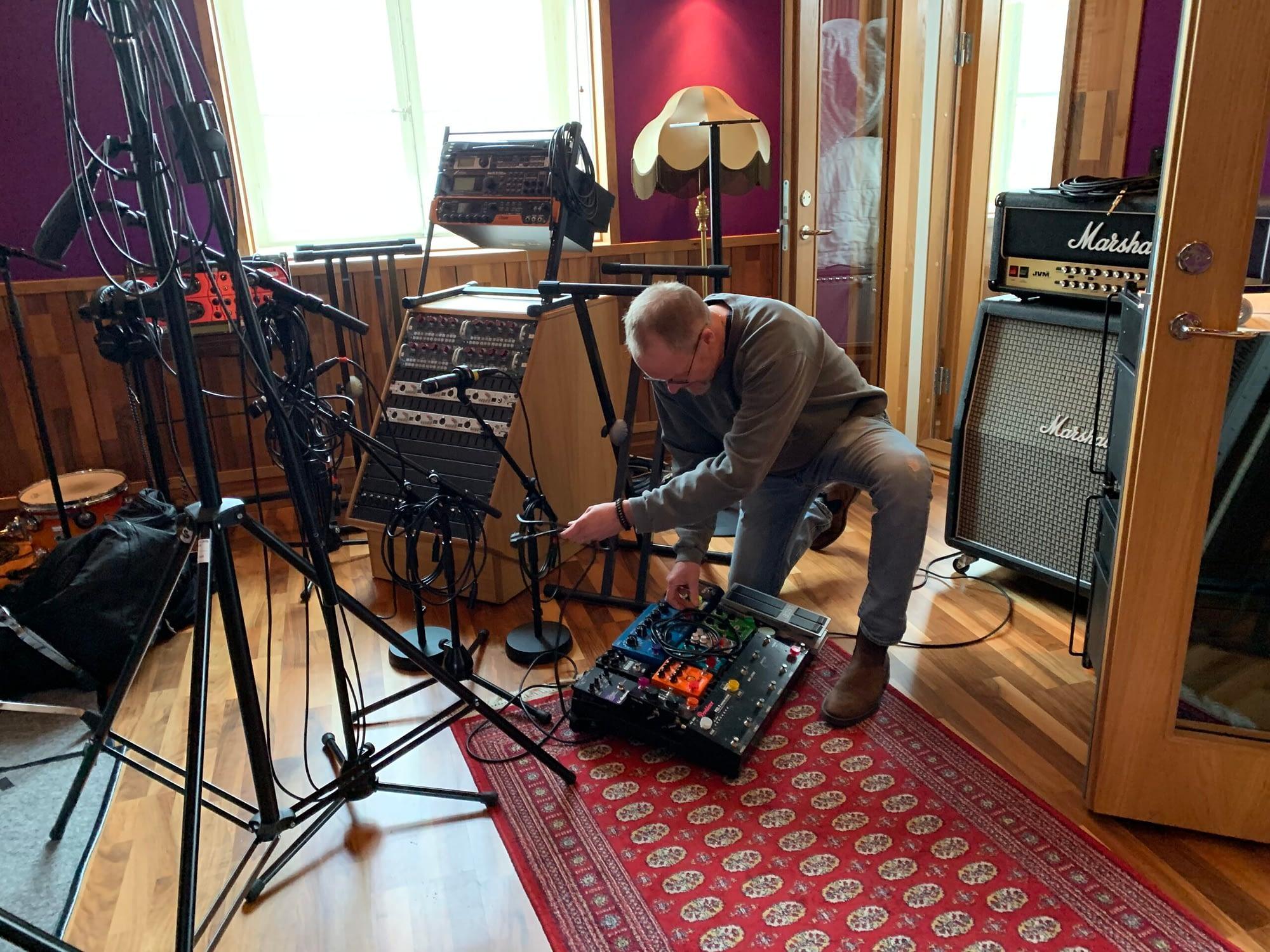 Guitarist Peter Enström prepares his guitar rig for recording
