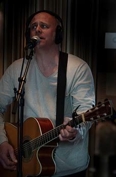 Matz records his vocals in the studio.