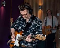 Guitarist Peter Gunnebro records electric guitar in the studio