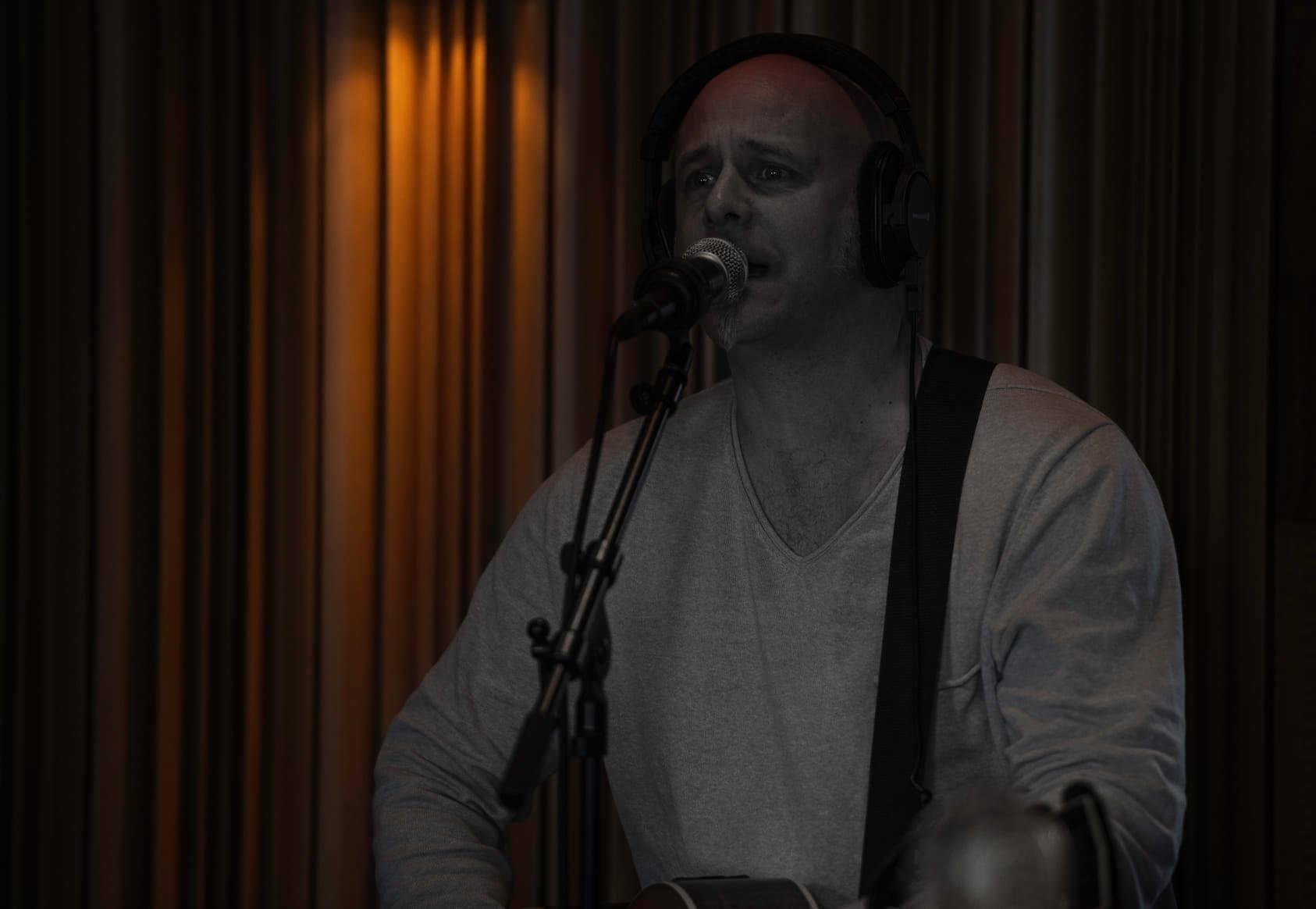Matz records guitar and vocals in the studio