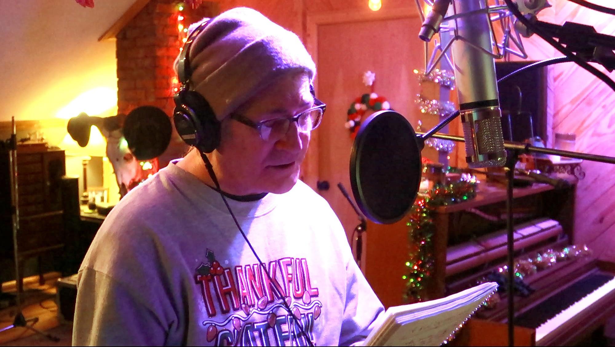 Photo of Doug Seegers recording vocals in his studio in Nashville.