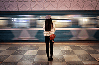 """Girl waiting for train on terminal. Descriptive picture of Tailor Hill Stations song """"Ain't Leaving Town""""."""