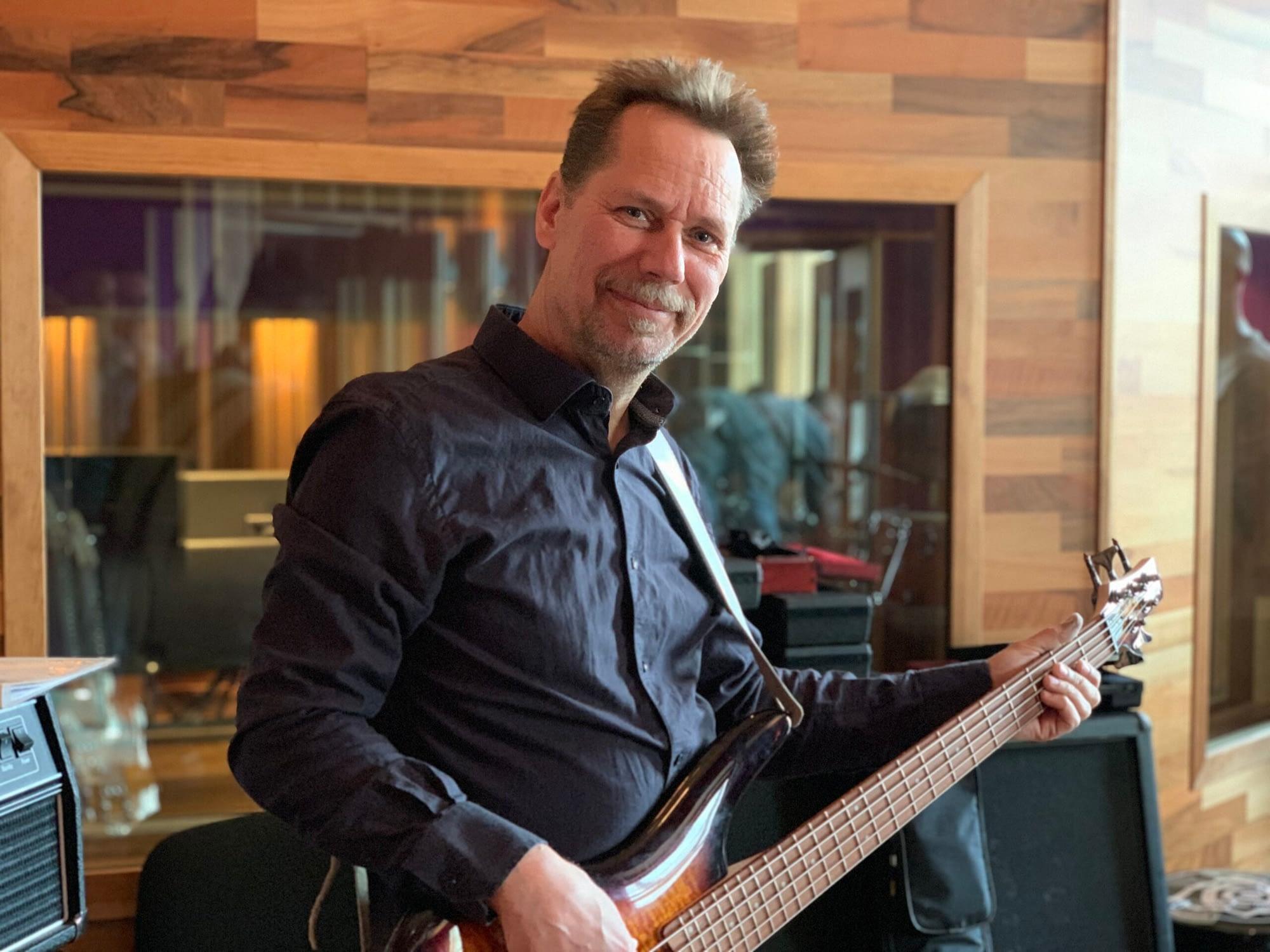 Bass player Thomas Midemyr recording electric bass