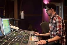 Sound engineer Anders Brandström sitting by the mixing console