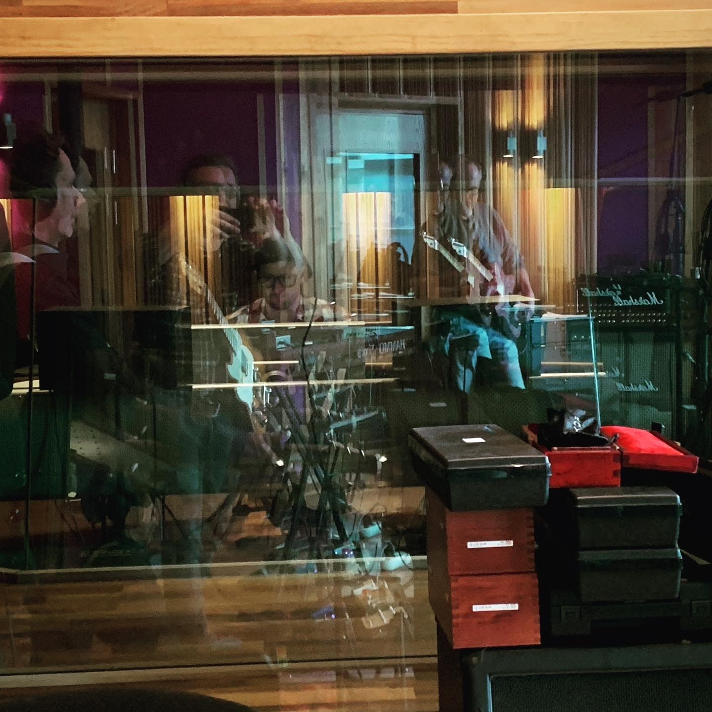 View from recording room through the window toward the control room