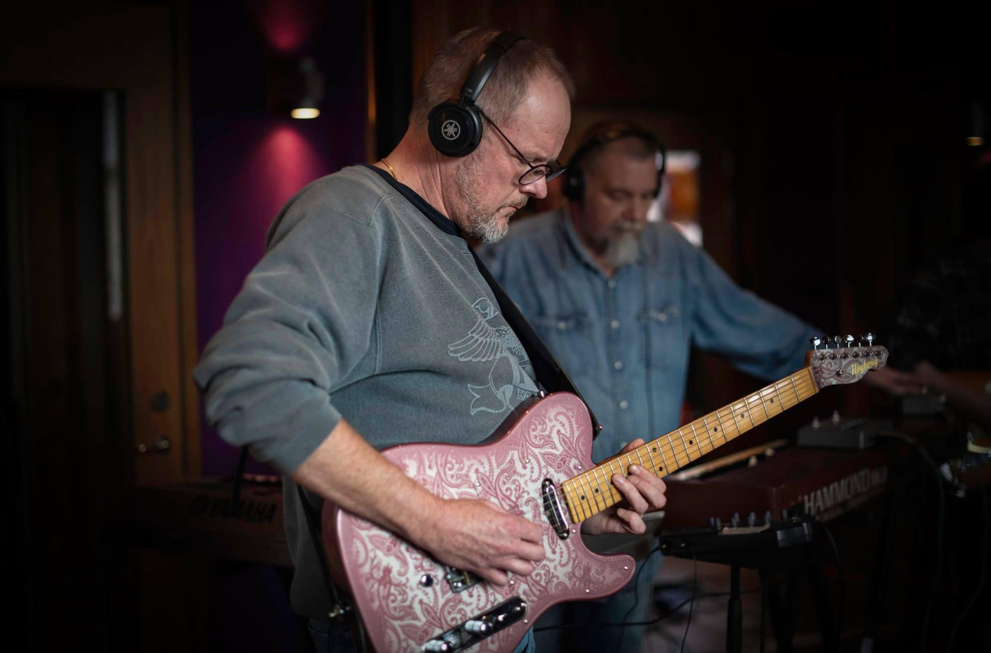 Guitarist Peter Enström records his electric guitar in the studio