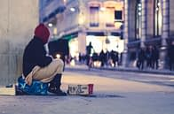 """Homeless boy sitting on the sidewalk. Descriptive picture of Tailor Hill Stations song """"A Kid On The Street""""."""