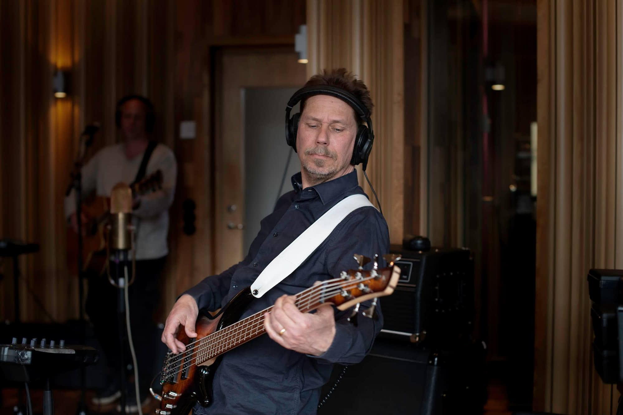 Bass player Thomas Midemyr records his electric bass in the studio